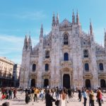 People in front of a building in Milan