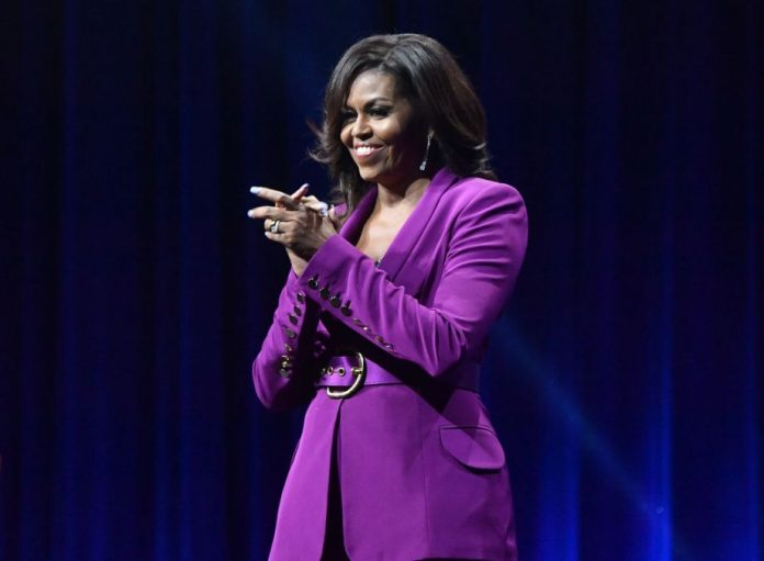 ATLANTA, GEORGIA - MAY 11: Former FirsProm Challenge by Michelle Obamat Lady Michelle Obama attends 'Becoming: An Intimate Conversation with Michelle Obama' at State Farm Arena on May 11, 2019 in Atlanta, Georgia. (Photo by Paras Griffin/Getty Images)